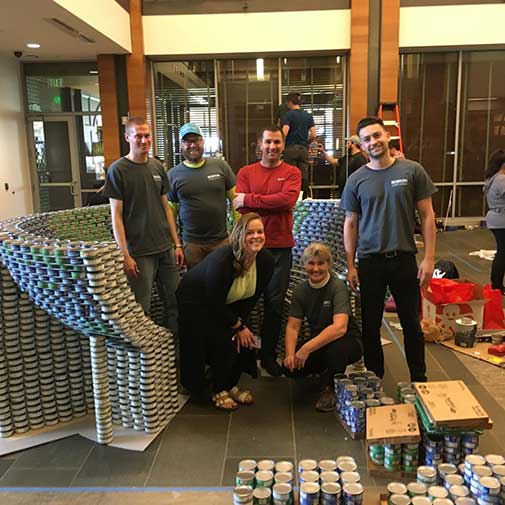 A shot of the DCBA-SMMA team with our 9000+ can sculpture for CANstruction Boston's charity competition.